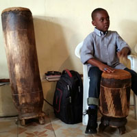 Young drummer accompanying choir