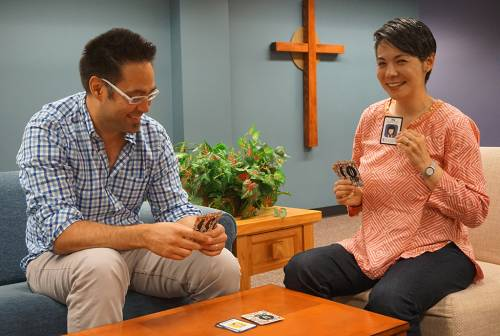 Jason Brian Santos and ministry colleague, Laura Cheifetz, Vice President of Church & Public Relations for the Presbyterian Publishing Corporation, play UGRAD. (Photo by Emily Enders Odom)