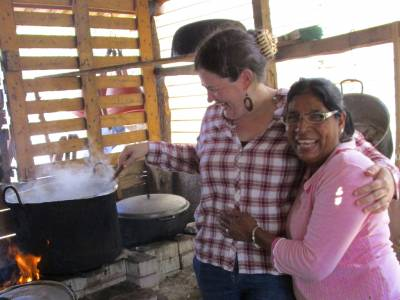 Sarah Henken takes a turn stirring soup with her friend Eunice, one of over 6 million internally displaced persons who are victims of the armed conflict in Colombia. (Photo by Rosaline Maria)