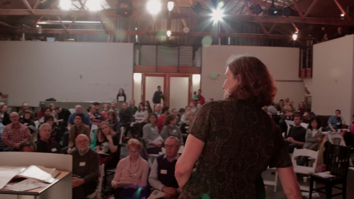 Renee Notkin in the space that Union uses for worship on Sundays, as space for the neighborhood to use during the week for things like non-profit events and business meetings, celebrations, and as women's shelter. Photo screen shot from video by Mike Fitzer, Film 180
