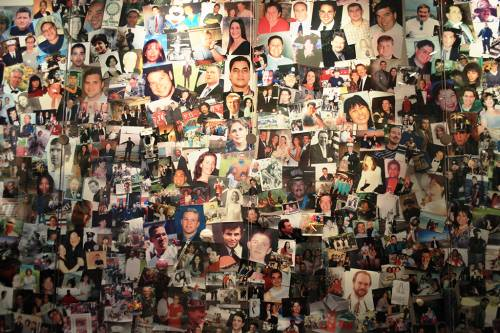 Close-up of Twin Towers victims, photo wall at World Trade Center Museum.