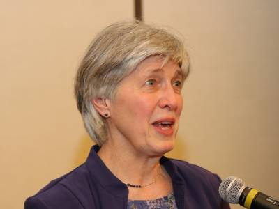 Presbyterian Intercultural Network president, Sharon Mook encourages individuals at the network's luncheon at GA 222 (2016) to attend the organization's upcoming conference at Columbia Theological Seminary. Photo by Tony Sibely