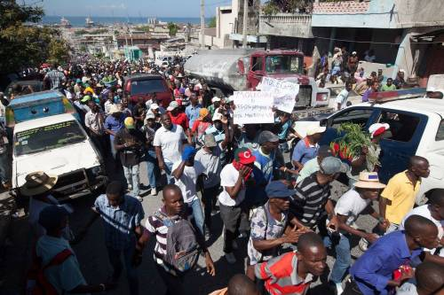 In early February, people flocked to the streets of Port-au-Prince to demand that President Michel Martelly step down. (Photo by Daniel Morel)