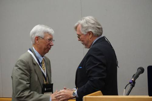 Michael Jinkins (right) presents medal to honoree Craig Dykstra. Photo by Emily Enders Odom.