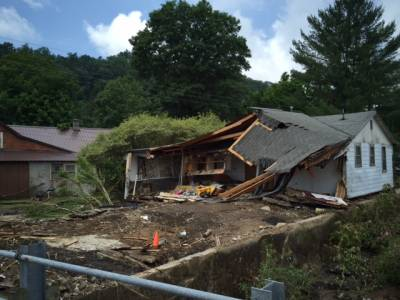 One of hundreds of homes damaged or destroyed by record flooding in West Virginia. Photo by Phillip Darby.