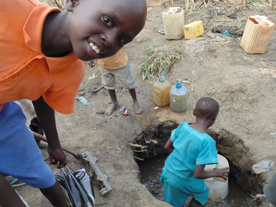 Water gathering at another primary school and a hopeful smile