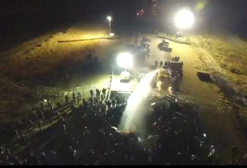 A drone captured aerial images of water cannons being used to douse Standing Rock water protectors in below-freezing temperatures. (Photo via Dallas Goldtooth's Facebook page)