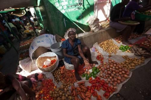 A woman sells produce in the market in Jacmel. (Photo by Daniel Morel)