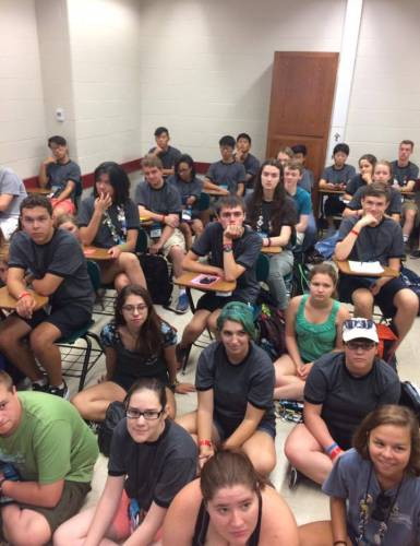 Teenagers attending the recent Youth Triennium crowded into a classroom to discuss environmental and racial justice issues. (Photo by Jennifer Evans)