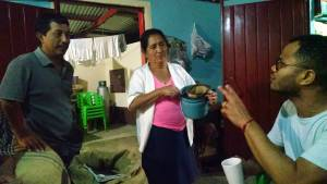 Robert Uribe (right), owner of Galiano's Café, visiting in the home of Lilia Velazquez and her son, David Cifuentes Velazquez. David, a Presbyterian elder, is another of the sons who have been able to return home because of Café Justo.