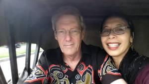 Bernie and Farsi ride in a becak in Aceh