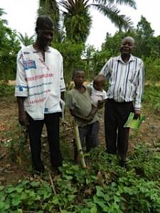 CHE volunteers (a local village chief and a seminary professor) planted this Moringa limb for these brothers