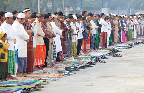 Muslim group in a line