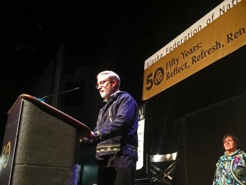 Curt Karns, executive presbyter of the Presbytery of Yukon, reads an apology before hundreds gathered October 22, 2016 for the Alaska Federation of Natives Convention in Fairbanks, Alaska. (Photo by Emily Schwing / Northwest News Network)