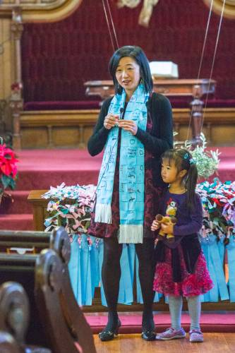 Theresa Cho, co-pastor of St. John's Presbyterian Church in San Francisco leads worship with her daughter, Isabella Kim. (Photo provided)