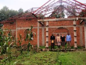 Nancy and Rev. Julie with Evangelist Jean (l) and parish elder (r) in front of the Kidaho Parish church building