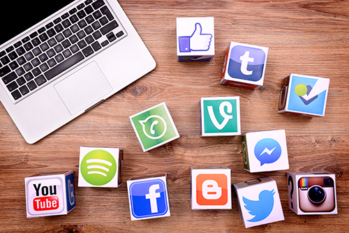 Computer with social media icons