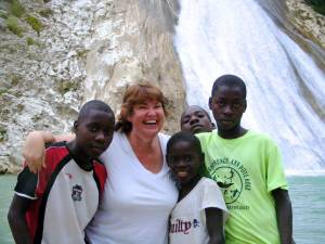 Mission co-worker Cindy Corell reunites with some friends at Bassin Zim, a popular waterfall in the Central Plateau of Haiti.