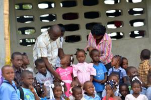 The director and teacher of a primary school that serves children living in the Eco-Villages near Hinche, Haiti, speak with a student. The school is the result of a partnership between a grassroots Haitian organization and a collaborative of Presbyterian churches in Georgia. About 25 percent of children in Haiti do not have the opportunity to attend school.