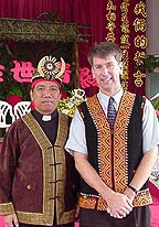 Photo of two men wearing colorful clothing.