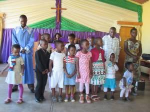 Children prepare to sing.
