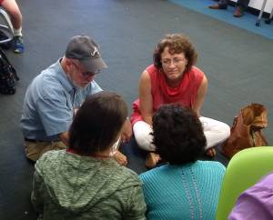 Presbyterians gather in small groups during the Big Tent workshop on Educate a Child. —Rick Jones