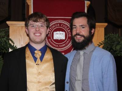 Logan Ellis (left) and Rev. Damen Heitmann, chaplain to Hastings College, in French Memorial Chapel. —Benjamin Ellis