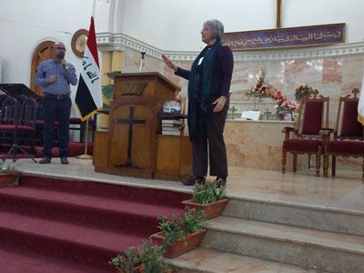 Elmarie preaching in Baghdad.