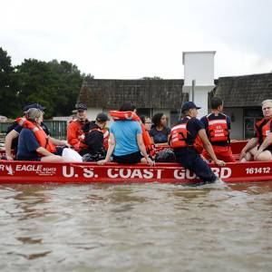 Coast Guardsmen rescue stranded residents from high water during severe flooding around Baton Rouge, La., Aug. 14, 2016. (Photo by Petty Officer 3rd Class Brandon Giles)