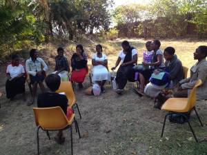 Chagodi Women's Centre - Group of women in life skills program meeting under the trees for a change.