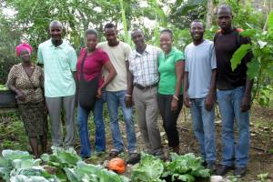 "The Road to Life Yard team in one of their garden spaces in MPP's national training center, ""Sant Lakay"" (the ""Feel-like-you-are-in-your-home Center""). From left to right: Diamène, Durosier Joachim, Dieu-la Joseph, Gultho Orné, Wilus Exil, Margory, Herve Delisma and Moxène Joachim."