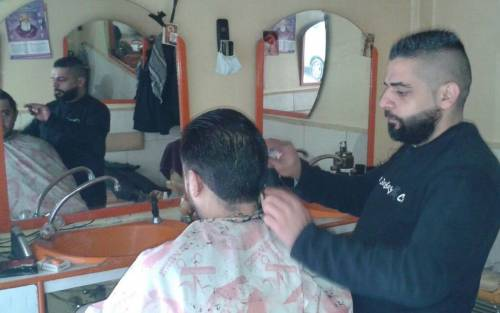 Harout working as a barber