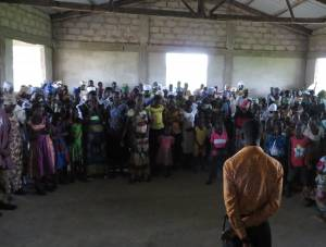 A young adult member of a Presbyterian congregation in northern Ghana leading a weekday prayer for the congregation. Young adults in their 30s and 40s eagerly lead many ministries and small groups in local congregations.