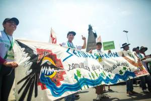 Photo credit: Joe Tobiason. Youth from Bolivia's Joining Hands network march for the climate