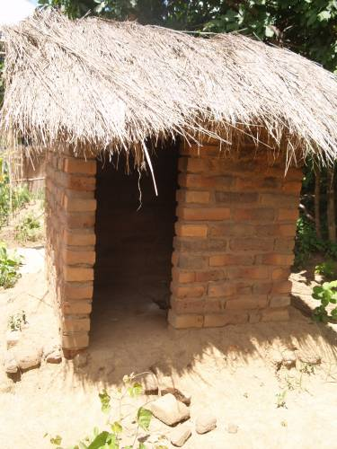 Traditional pit latrine in Malawi