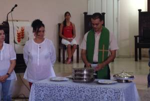 Rev. Marlon Irrarragorry, of the Presbyterian-Reformed Church in Cuba, celebrates The Lord's Supper in his congregation