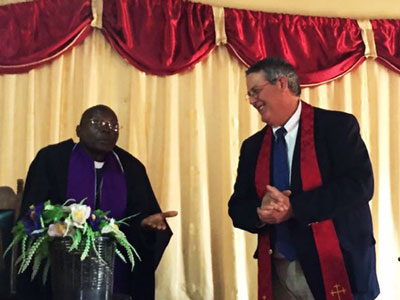 Rev. David Chiboboka translates Charles' sermon, The Cost of Following Christ