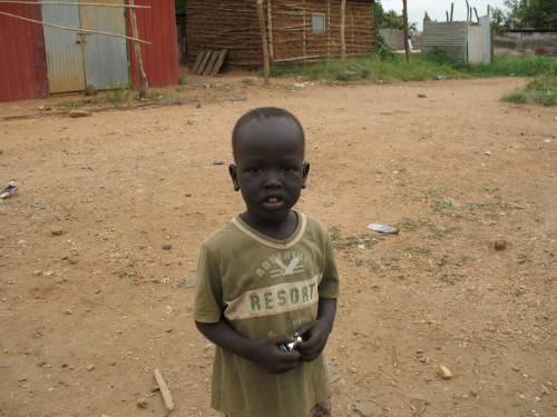A future student at the first school building being built in partnership with the South Sudan Education and Peace Building Project