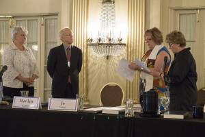 Marsha Zell Anson and Ken Godshall are installed as vice-chair and chair of the Presbyterian Mission Agency Board by former chair Marilyn Gamm and former vice-chair Jo Stewart. —Gregg Brekke