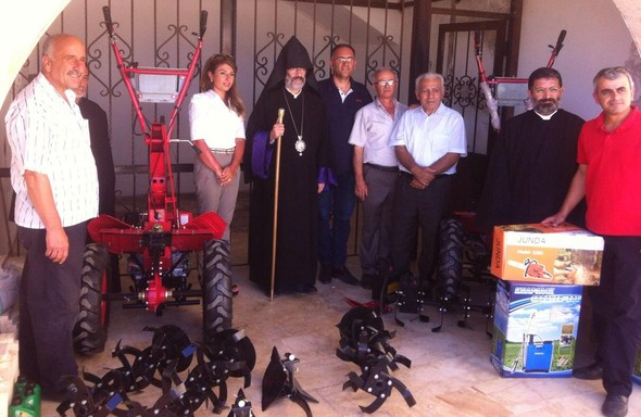 JMP director with local Kessab leaders and clergy with new farm equipment