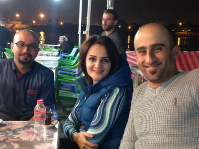 """Enjoying """"masguf"""" with friends on the banks of the Tigris river."""