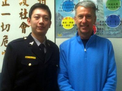 John with police chief Chen Yi Kai