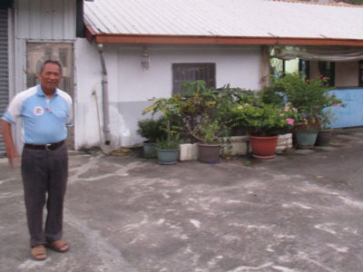 Elder Bavan in front of his one-story home where we spent the night of the typhoon