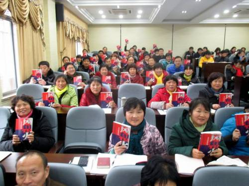 Rural evangelists in China with my newly published book on the Holy Spirit