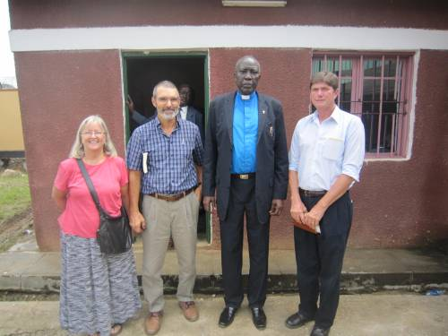 PCUSA mission co-workers Lynn and Sharon Kandel, Rev. Peter Gai, and Jim after a church service in Juba, South Sudan.