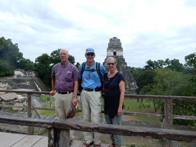 Jim, Richard, and Debbie atop a Mayan pyramid in Tikal