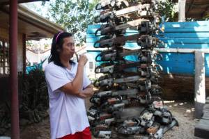 Atty. Bobby Chan of the Palawan NGO Network Inc showing a stacked-up pile of confiscated chain saws used for illegal logging in the forests of Palawan