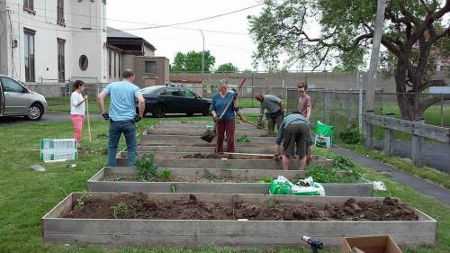 Isaiah's Table participants preparign gardens for neighbors and Food Pantry guests.