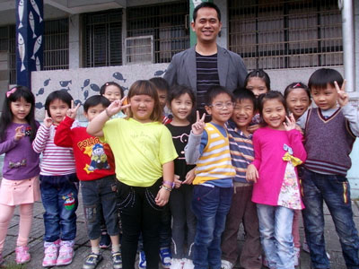 School principal Libunu with elementary school children