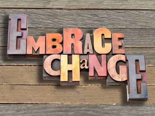 Wooden blocks that spell out Embrace Change